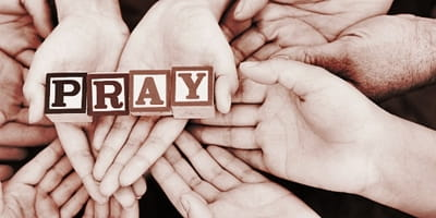 10691-hands-pray-holding-people main.400w.tn.jpg